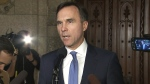 Finance Minister Bill Morneau takes questions after making an announcement on 'income sprinkling'
