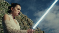 "This image released by Lucasfilm shows Daisy Ridley as Rey in ""Star Wars: The Last Jedi,"" in theaters on Dec. 15. (Lucasfilm via AP)"