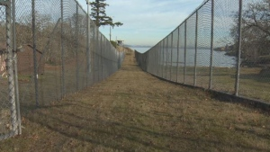 A prison fence on Vancouver Island is seen here in a 2017 file photo.