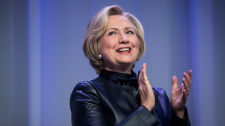 Hillary Clinton applauds as she walks on stage for a book tour event in Vancouver, B.C., on Dec. 13, 2017. (THE CANADIAN PRESS/Darryl Dyck)