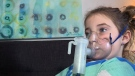 A machine pumps medicine into the lungs of nine-year-old Cassidy Evans, who has cystic fibrosis.
