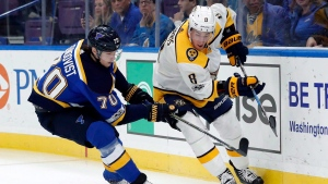 St. Louis Blues' Oskar Sundqvist, of Sweden, left, and Nashville Predators' Kyle Turris, right, chase after a loose puck during the first period of an NHL hockey game Friday, Nov. 24, 2017, in St. Louis. (THE CANADIAN PRESS / AP / Jeff Roberson)