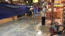 Staff members attempting to remove water following Wednesday's water main break at Calgary Farmers' Market