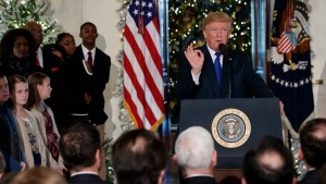 U.S. President Donald Trump speaks on tax reform in the Grand Foyer of the White House, Wednesday, Dec. 13, 2017, in Washington. (AP Photo/Evan Vucci)