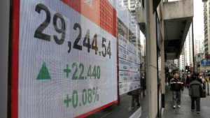 An electronic stock board shows the Hang Seng Index at a bank in Hong Kong, Thursday, Dec. 14, 2017. (AP Photo/Kin Cheung)
