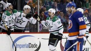Dallas Stars right wing Alexander Radulov congratulates Stars left wing Jamie Benn after Benn scored a goal during the second period of an NHL hockey game against the New York Islanders in New York, Wednesday, Dec. 13, 2017. (AP Photo/Kathy Willens)