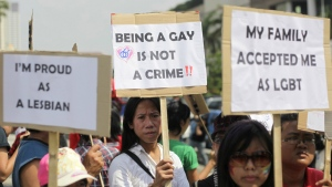 Indonesian gay activists hold posters during a protest demanding equality for LGBT (Lesbian, gay, bisexual and transgender) people in Jakarta, Indonesia on Saturday, May 21, 2011. (AP Photo/Dita Alangkara)