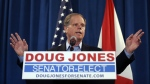 Sen.-elect Doug Jones speaks during a news conference in Birmingham, Ala. on Wednesday, Dec. 13, 2017. (AP Photo/John Bazemore)