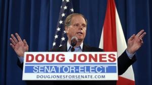 Sen.-elect Doug Jones speaks during a news conference in Birmingham, Ala. on Wednesday, Dec. 13, 2017. (AP Photo/John Bazemore)