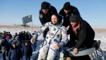 Russian space agency rescue team take off from the capsule U.S. astronaut Randy Bresnik shortly after the landing of the Russian Soyuz MS-05 space capsule about 150 km south-east of the Kazakh town of Zhezkazgan, Kazakhstan, Thursday, Dec. 14, 2017. Three astronauts on Thursday landed back on Earth after nearly six months aboard the International Space Station. (AP Photo/Dmitri Lovetsky, Pool)