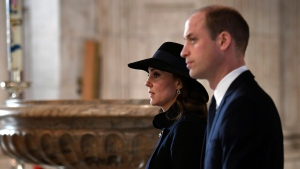 Catherine, the Duchess of Cambridge and Prince William attend the Grenfell Tower National Memorial Service at St Paul's Cathedral, in London, to mark the six month anniversary of the Grenfell Tower fire, Thursday Dec. 14, 2017. (Stefan Rousseau/Pool Photo via AP)