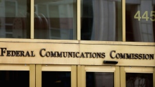 """FILE - This June 19, 2015, file photo, shows the entrance to the Federal Communications Commission (FCC) building in Washington. """"Net neutrality"""" regulations, designed to prevent internet service providers like Verizon, AT&T, Comcast and Charter from favoring some sites and apps over others, are on the chopping block. Federal Communications Commission Chairman Ajit Pai, a Republican, on Tuesday, Dec. 12, 2017, unveiled a plan to undo the Obama-era rules that have been in place since 2015. (AP Photo/Andrew Harnik, File)"""