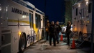 An multi-patient ambulance and and SIU mobile unit are photographed after a gunman was killed by police at a bank in Maple, Ont., on Wednesday, December 13, 2017. THE CANADIAN PRESS/Christopher Katsarov