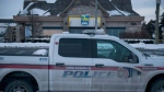 Police secure the area surrounding a bank where a gunman was killed in Maple, Ont., on Wednesday, December 13, 2017. THE CANADIAN PRESS/Christopher Katsarov