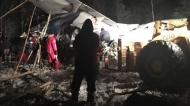 RCMP say a plane with 25 people on board has crashed in northern Saskatchewan shortly after taking off around 6:15 p.m. Wednesday at the Fond du Lac airport. First responders work the crash scene near the Fond du Lac airport in a Wednesday, December 13, 2017, image posted to social media. THE CANADIAN PRESS/HO-Facebook, Raymond Sanger, *MANDATORY CREDIT*