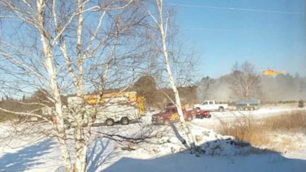 At the scene of a helicopter crash in eastern Ontario, on Dec. 14, 2017.