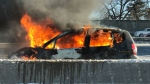 A car on fire on Highway 401 near Bayview Avenue, which blocked all eastbound express lanes on Thursday, December 14, 2017 for a portion of the afternoon.( Photo courtesy of @JeffReason/Twitter)