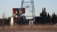 O.P.P. and Hydro One trucks stand near a Hydro One crash near Tweed, Ont., on Dec. 14, 2017. Four Hydro One employees were killed Thursday in a helicopter crash in eastern Ontario, police and the utility reported.The crash occurred about noon in Tweed, north of Kingston, provincial police said. THE CANADIAN PRESS/Lars Hagberg