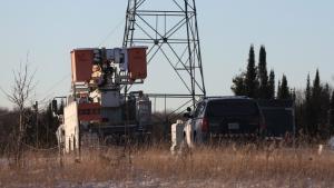 OPP and Hydro One trucks stand near a Hydro One crash near Tweed, Ont., on Dec. 14, 2017. (THE CANADIAN PRESS/Lars Hagberg)