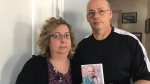 Brenda and Terence Roberts hold a picture of their late daughter, Kyra. She passed away in August at 25. They are looking for a missing USB stick with pictures of Kyra that was stolen from their van on Dec. 12, 2017 (Rich Garton / CTV Windsor)