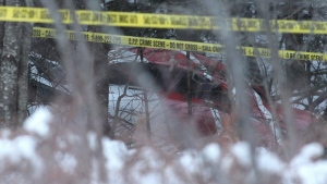The crash Hydro One helicopter can be seen at the crash site near Tweed, Ont., on Dec. 14, 2017. (THE CANADIAN PRESS / Lars Hagberg)