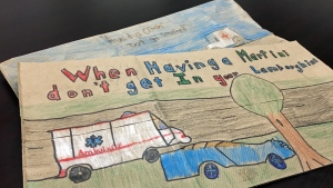 Bags decorated with drawings from elementary students warn customers at a government-run liquor store on Saskatoon's Eighth Street of the dangers of impaired driving.