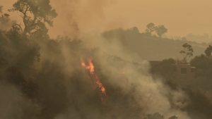Pockets of unburned vegetation flare up off Bella Vista Dr. in Montecito, Calif. on Wednesday, Dec. 13, 2017. (Mike Eliason/Santa Barbara County Fire Department)