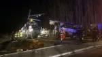 Rescue workers help after a school bus and a regional train collided in the village of Millas, southern France, Thursday, Dec. 14, 2017. (Matthieu Ferri/France Bleu)
