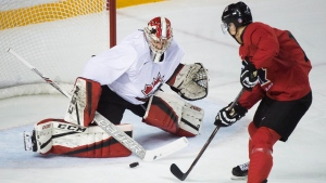 USports goalie Samuel Harvey (1) makes save against Canada's Nick Suzuki (18) during first period exhibition hockey action in preparation for the upcoming IIHF World Junior Championships in St. Catharines, Ont., on Dec. 14, 2017. THE CANADIAN PRESS/Nathan Denette