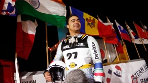 Shiva Keshavan, of India, speaks with reporters after competing in the Nations Cup luge race, a World Cup qualifier, in Lake Placid, N.Y., on Dec. 14, 2017. (AP Photo/Peter Morgan)