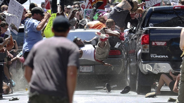 A vehicle is driven into a group of protesters demonstrating against a white nationalist rally in Charlottesville, Va., on Aug. 12, 2017. (Ryan M. Kelly/The Daily Progress via AP, File)