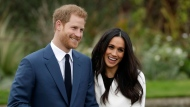 Prince Harry and his fiancee Meghan Markle pose for photographers during a photocall in the grounds of Kensington Palace in London. (AP Photo/Matt Dunham)