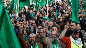 Palestinian Hamas supporters attend a rally marking the 30th anniversary of Hamas movement in the West Bank City of Nablus, Friday, Dec. 14, 2017. (AP Photo/Majdi Mohammed)
