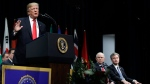 President Donald Trump speaks during the FBI National Academy graduation ceremony, Friday, Dec. 15, 2017, in Quantico, Va. (AP Photo/Evan Vucci)