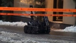 The Montreal police bomb disposal robot rolls along Peel St. on Dec. 15, 2017
