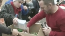 Firefighters pack hampers for families in need