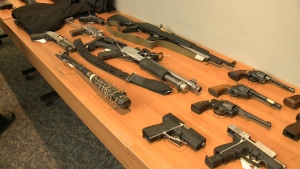 Some of the firearms and weapons seized by Ottawa Police during Project Sabotage are displayed on a table during a media conference on Friday, Dec. 15, 2017. (CTV Ottawa)