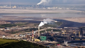The Suncor oil sands facility seen from a helicopter near Fort McMurray, Alta., Tuesday, July 10, 2012. THE CANADIAN PRESS/Jeff McIntosh