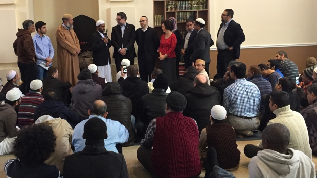 Imams at the Ahl-Ill-Bait mosque with Quebec Immigration Minister David Heurtel, CDN-NDG borough mayor Sue Montgomery, councillor Lionel Perez and others on Friday Dec. 15, 2017 (CTV Montreal/Rob Lurie)