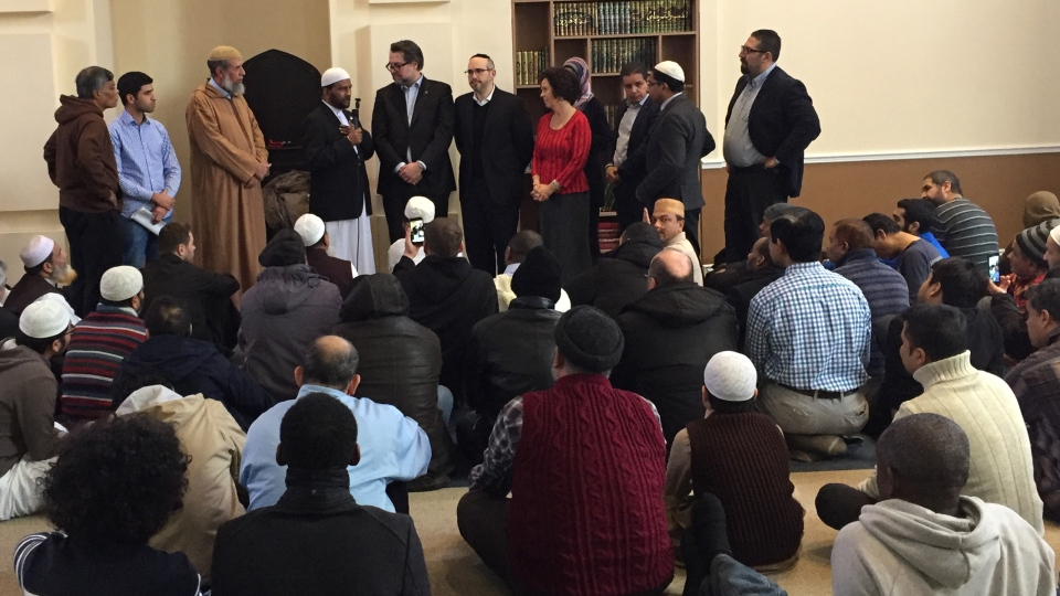 Imams with Quebec Immigration Minister David Heurtel, CDN-NDG Borough Mayor Sue Montgomery, councillor Lionel Perez and others on Friday Dec. 15, 2017 (CTV Montreal/Rob Lurie)