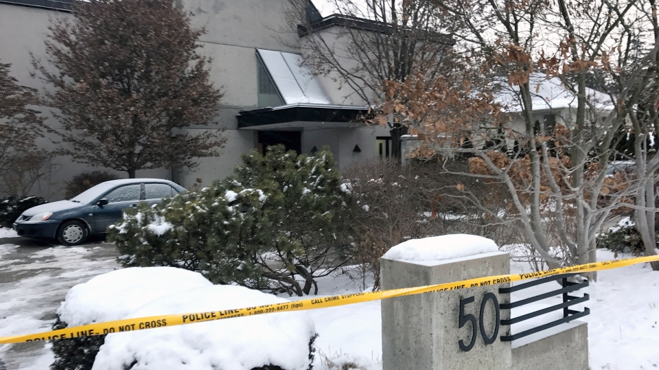 Police tape blocks off the front of a home in Toronto's York Mills where the bodies of two people were found on Dec. 15, 2017. (Natalie Johnson/CTV News Toronto)