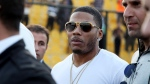 In this 2015 file photo rapper Nelly approaches the stage for a concert in Iraq. (AP Photo/Seivan M. Salim, File)