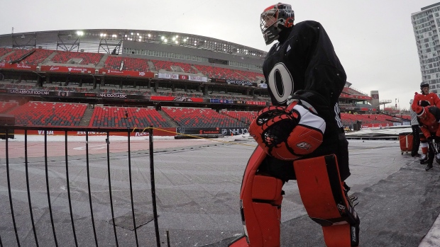 Ottawa Senators goalie Craig Anderson leaves the ice following practice at the outdoor rink ahead of the NHL 100 Classic Friday December 15, 2017 in Ottawa. The Ottawa Senators will play the Montreal Canadiens in the NHL 100 Classic outdoor hockey game. (Adrian Wyld/THE CANADIAN PRESS)