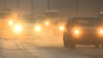 Vehicles on snow-covered street in Calgary (file)