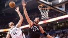 Toronto Raptors centre Jonas Valanciunas (17) and Brooklyn Nets centre Tyler Zeller (44) battle for a rebound during second half NBA basketball action in Toronto on Friday, December 15, 2017. THE CANADIAN PRESS/Frank Gunn