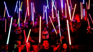 Star Wars fans raise their lightsabers before the starts of 'Star Wars: The Last Jedi' movie in Subang Jaya, Malaysia, Friday, Dec. 15, 2017. (AP Photo/Sadiq Asyraf)
