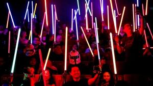 Star Wars fans raise their lightsabers before the starts of 'Star Wars: The Last Jedi' movie in Subang Jaya, Malaysia, Friday, Dec. 15, 2017. (AP Photo/Sadiq Asyraf)