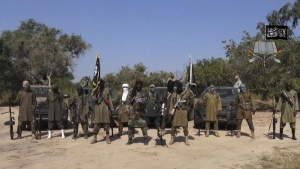 In this file image taken from video released Friday Oct. 31, 2014, by Boko Haram, Abubakar Shekau, centre, the leader of Nigeria's Islamic extremist group, surrounded by his fighters.  (AP Photo/Boko Haram,File)
