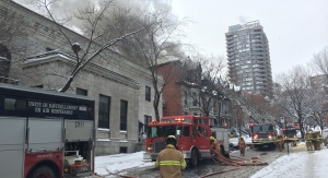 Firefighters respond to a four-alarm fire on Stanley St. on Saturday, Dec. 16, 2017. (Photo: JL Boulch/CTV Montreal)