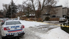 Police remain on the scene outside of the home of Barry Sherman in Toronto after he and his wife Honey were found dead in the basement. (CTV)